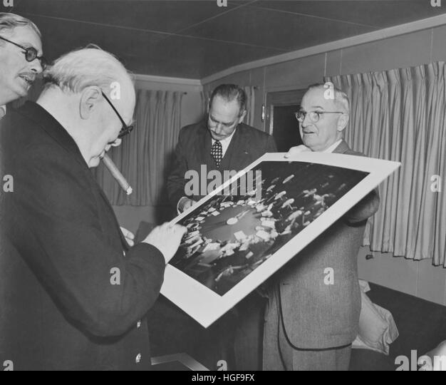 President Truman presenting British Prime Minister Winston Churchill with a photograph taken at the Potsdam Conference - Stock Image