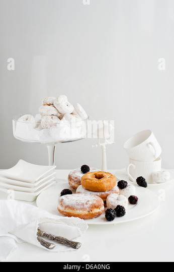 Plates of donuts with fruit - Stock Image