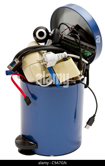 small trashcan with electronic waste on white background - Stock Image