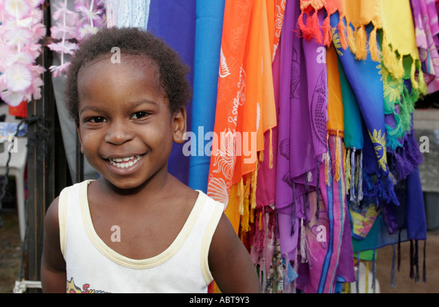 BVI Tortola Tent Village Road Town Cruise Port smiling Black boy - Stock Image