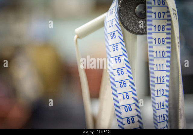 Tape measure in clothing factory, close up - Stock-Bilder