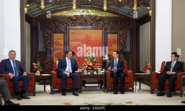 Beijing, China. 8th July, 2015. Chinese Vice Premier Zhang Gaoli (2nd R) meets with Anatoly Kalinin (2nd L), deputy - Stock Image