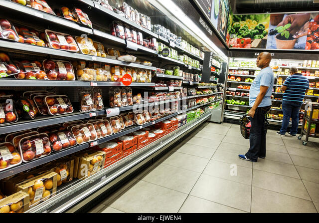 Johannesburg South Africa African Rosebank The Zone Mall Woolworths grocery store supermarket shopping inside food - Stock Image