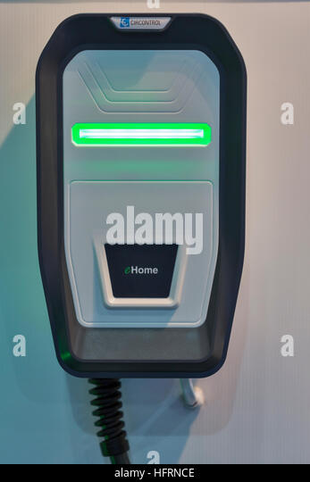 Electric vehicle fast car charger for electric and hybrid cars at 1st International Trade Show of Electric Vehicles - Stock Image