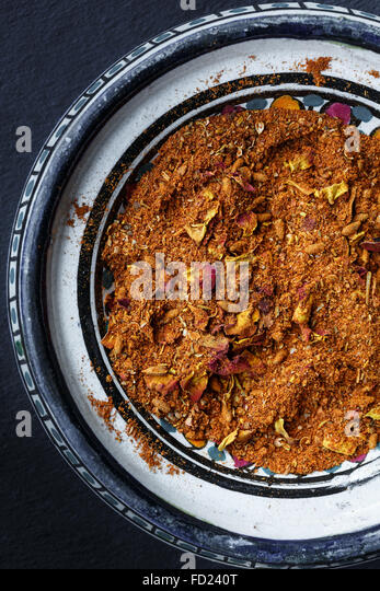 Ras el hanout (Moroccan spice mixture) in a bowl - Stock Image
