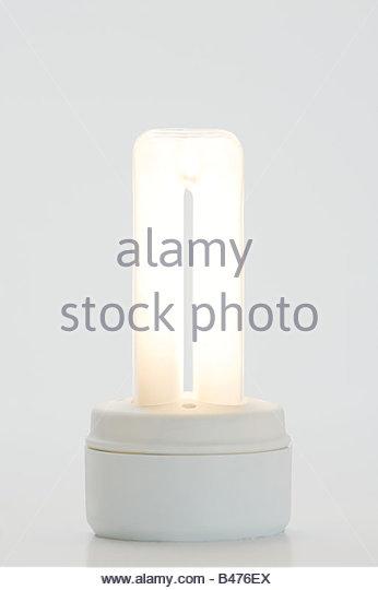 An illuminated energy saving lightbulb - Stock Image
