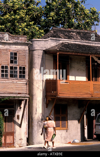 Barbados West Indies Caribbean Bridgetown Two Women Walking by Old Buildings - Stock Image