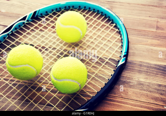 Tennis game. Tennis ball on wooden background. Vintage retro picture. - Stock-Bilder