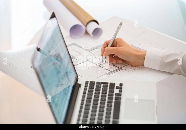 Woman Architect drawing on print construction Project - Stock Image