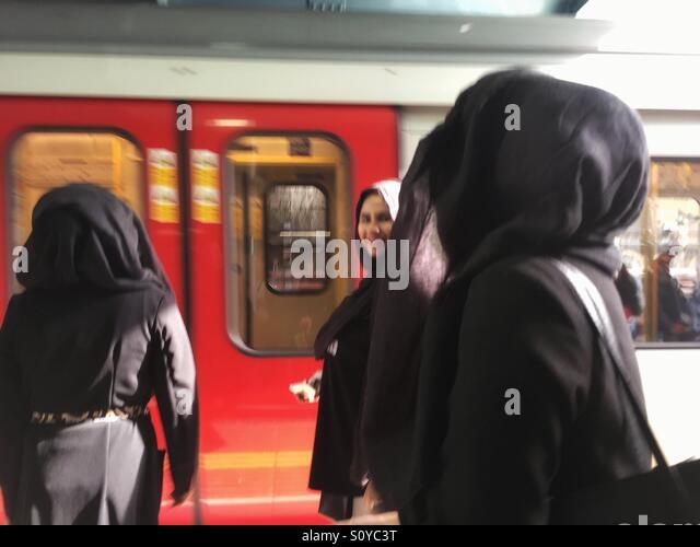 Muslim women in hijab, burka or Niqab at Whitechapel station, London, U.K - Stock Image