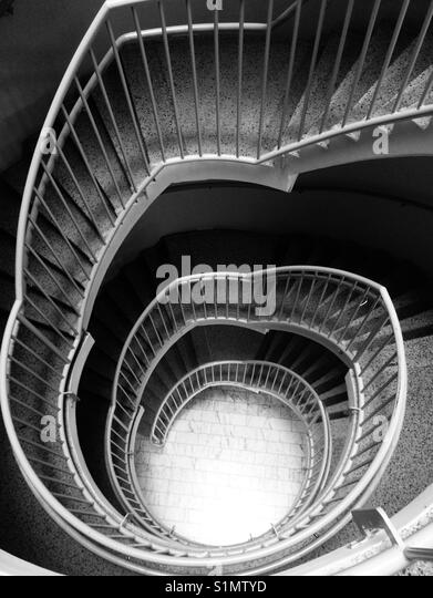 Spiral staircase in black and white - Stock Image