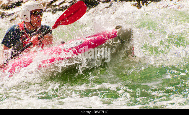 USA,Idaho, Rafting Middle Fork of the Salmon River. Man paddling kayak through churning whitewater rapids. - Stock Image