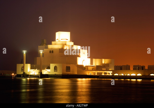 Museum of islamic art by famous architect I M Pei at the promanade of Doha corniche at night - Stock Image