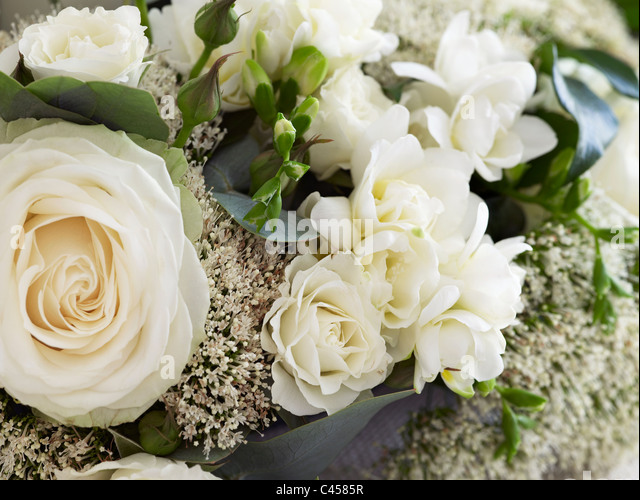 Bunch of flowers including white roses, close-up - Stock Image
