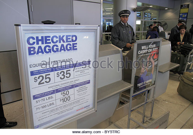 Miami Florida Miami International Airport MIA American Airlines departure level curb side check-in baggage luggage - Stock Image