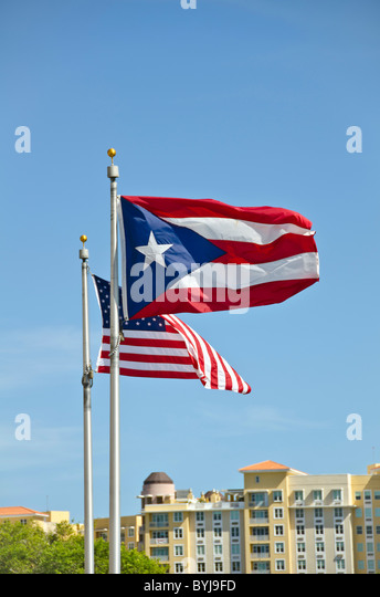Puerto Rico and United States of America flags flying side by side - Stock Image