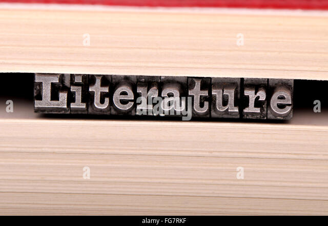 Letterpress characters spelling out 'literature' in the pages of a book - Stock Image