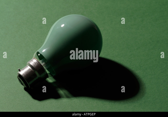 Green light bulb - Stock Image