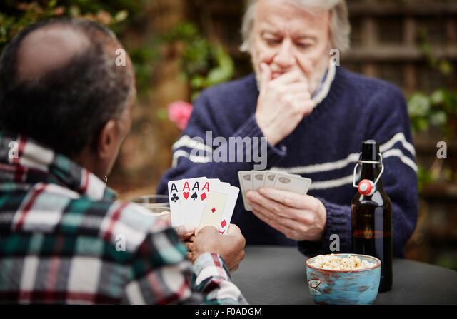 Two senior men playing cards - Stock Image