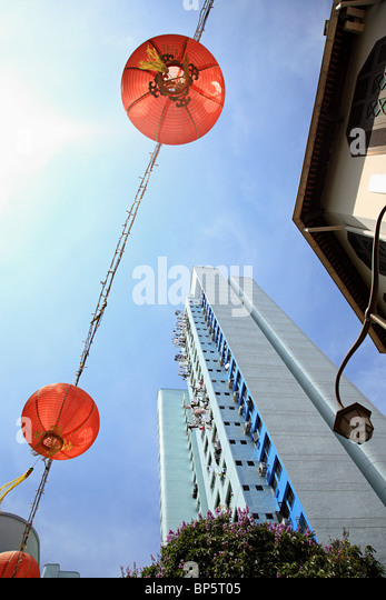 Lanterns and high rise in singapore china town - Stock Image