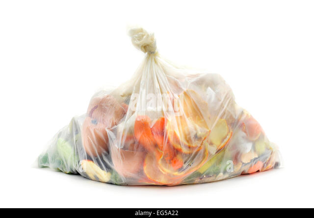 biodegradable bag full of biodegradable waste on a white background - Stock Image