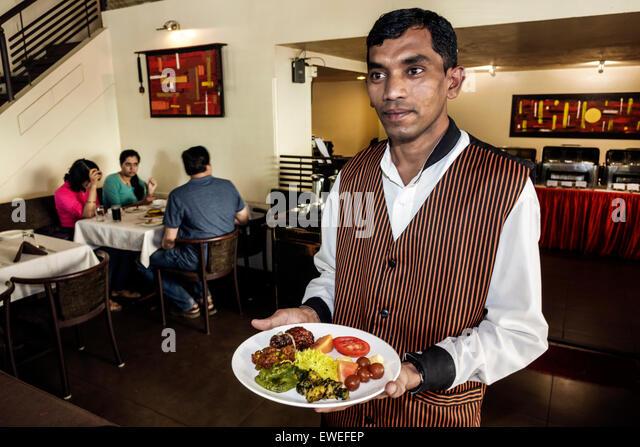 Mumbai India Indian Asian Churchgate Veer Nariman Road Indian Summer restaurant buffet style line waiter server - Stock Image