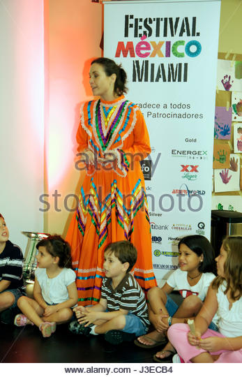 Miami Florida Miami Art Central Festival Mexico Miami Jalisco dress outfit Hispanic woman girls boys children teach - Stock Image