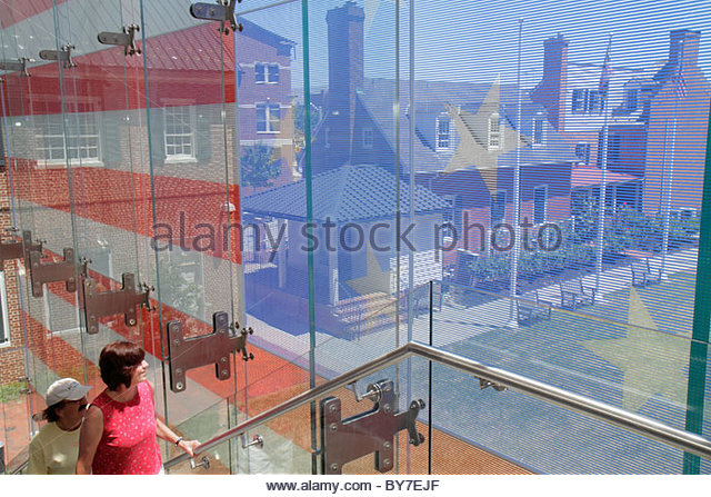 Baltimore Maryland East Pratt Street Star Spangled Banner Flag House museum history interior stairs glass facade - Stock Image