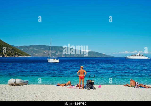 Greece Beach Sunbathing Woman Stock Photos & Greece Beach ...