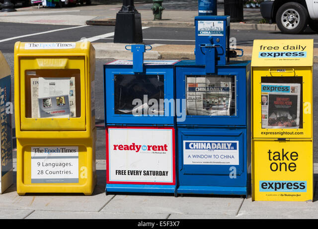 Colorful newspaper stands in Washington DC, USA holding free and paid newspapers including China Daily and Epoch - Stock-Bilder