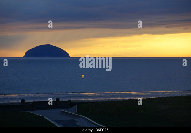 View of Ailsa Craig at dusk from Girvan sea front - Stock Image
