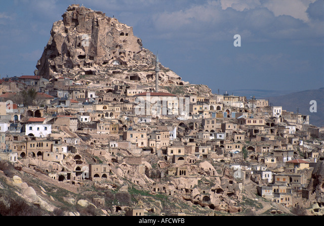 Turkey Cappadocia Goreme Valley dwellings carved from volcanic tufa mound - Stock Image