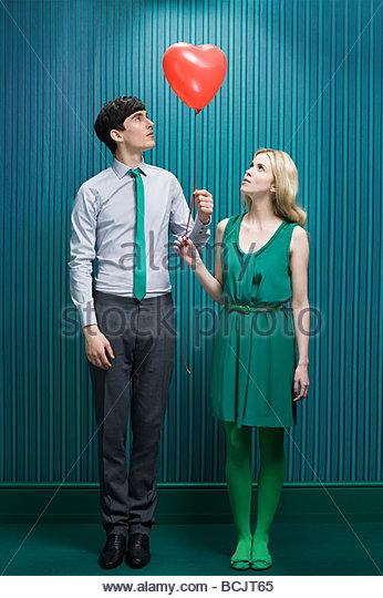 Couple with heart shape balloon - Stock-Bilder