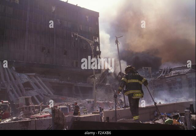 Fire fighters amid smoking rubble following September 11th terrorist attack on World Trade Center. Photo shows the - Stock-Bilder