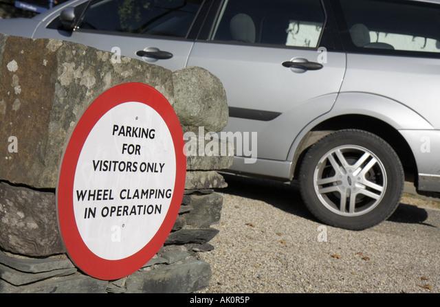 UK, England, Grasmere, sign, wheel clamping, parking, - Stock Image