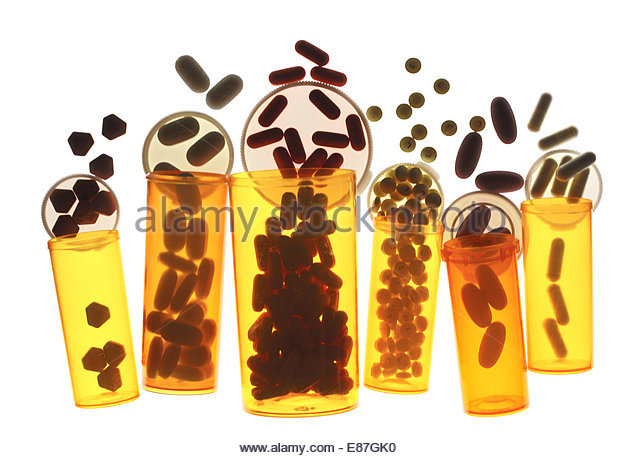 Different medical bottles of pills & tablets isolated on white - Stock Image