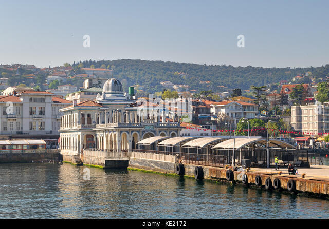Istanbul, Turkey - April 27, 2017: Buyukada (Princess Island) Ferry Terminal with passengers riding a ferry and - Stock Image