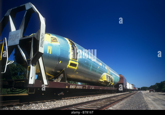 Fuselage of an aircraft being transported by train, USA - Stock Image