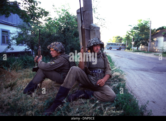 Russian Interior Ministry soldiers wearing body armor, hold Kalashnikov rifles near the Budyonnovsk hospital in1995 - Stock Image
