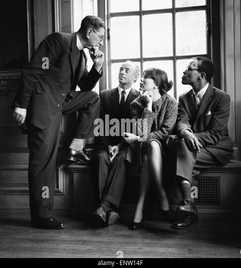 Singers Dave Lambert, Jon Hendricks and Annie Ross talking to Reverend Collins. 2nd March 1959. - Stock Image