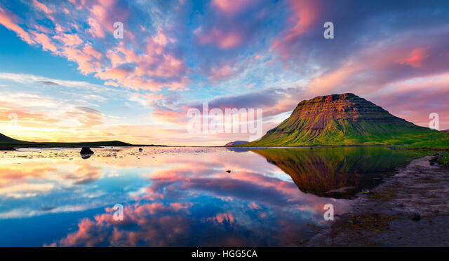 Colorful summer sunset with Kirkjufell Mountain in Grundarfjordur town. Evening scene on the Snaefellsnes peninsula, - Stock Image
