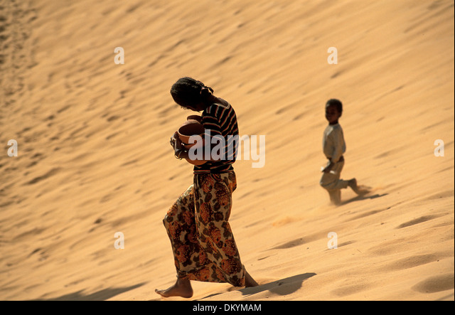 Tuareg population of Timimoun in Algeria. - Stock Image