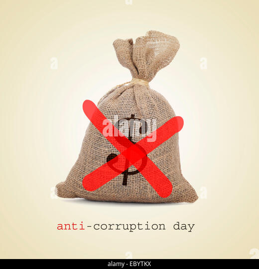 a burlap money bag with two diagonal red slashes for the anti-corruption day - Stock Image