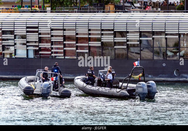 Paris, France. 24th Jun, 2017. French police boats patrolling on the Seine river during the Paris Olympic Games - Stock Image