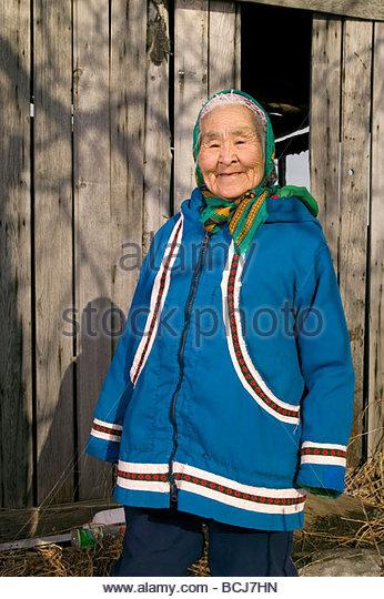 akiak women Pictures summer 2014 grayling  hanging out in akiak marshall, ak  yupiq woman preparing smoked king salmon strips for storage ice road to kwethluk.