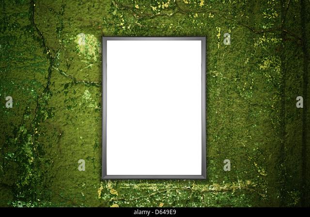 Light ad display on green grunge wall. Advertising billboards - Stock Image
