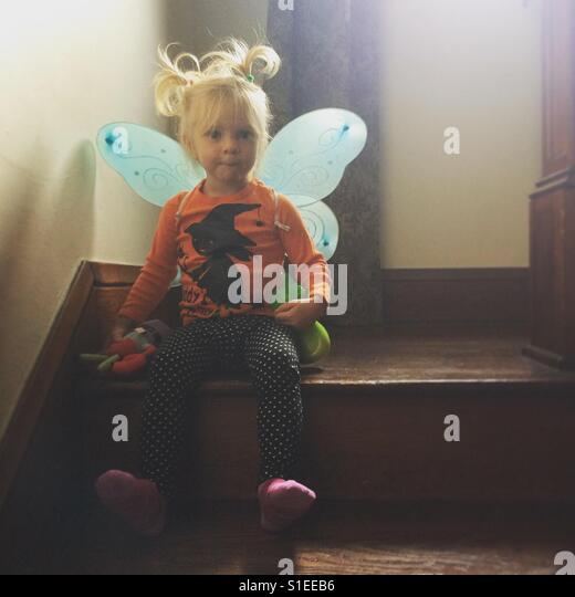 Little girl with pigtails and fairy wings - Stock-Bilder