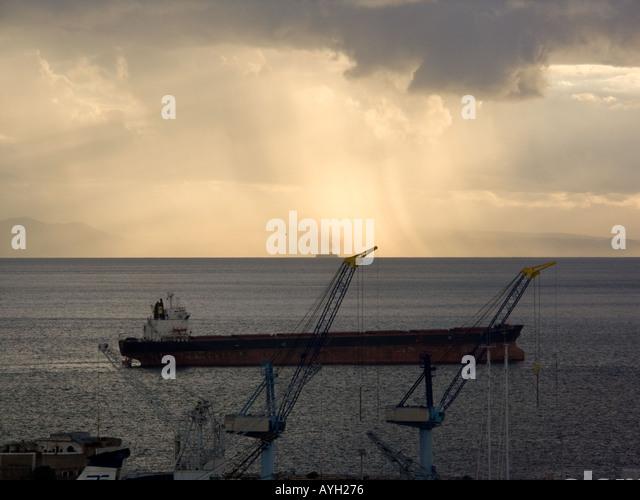 Sunset over the Bay of Gibraltar, sunset sunsets dusk ship ships shipping tanker tankers Bay of Gibraltar Gibraltarian - Stock Image