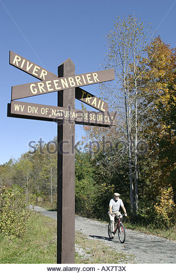 West Virginia Lewisburg Greenbrier River Trail cyclist - Stock Image