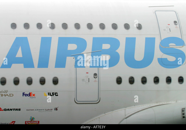 Sign Airbus on the fuselage of largest passenger jet aeroplane A380 - Stock Image